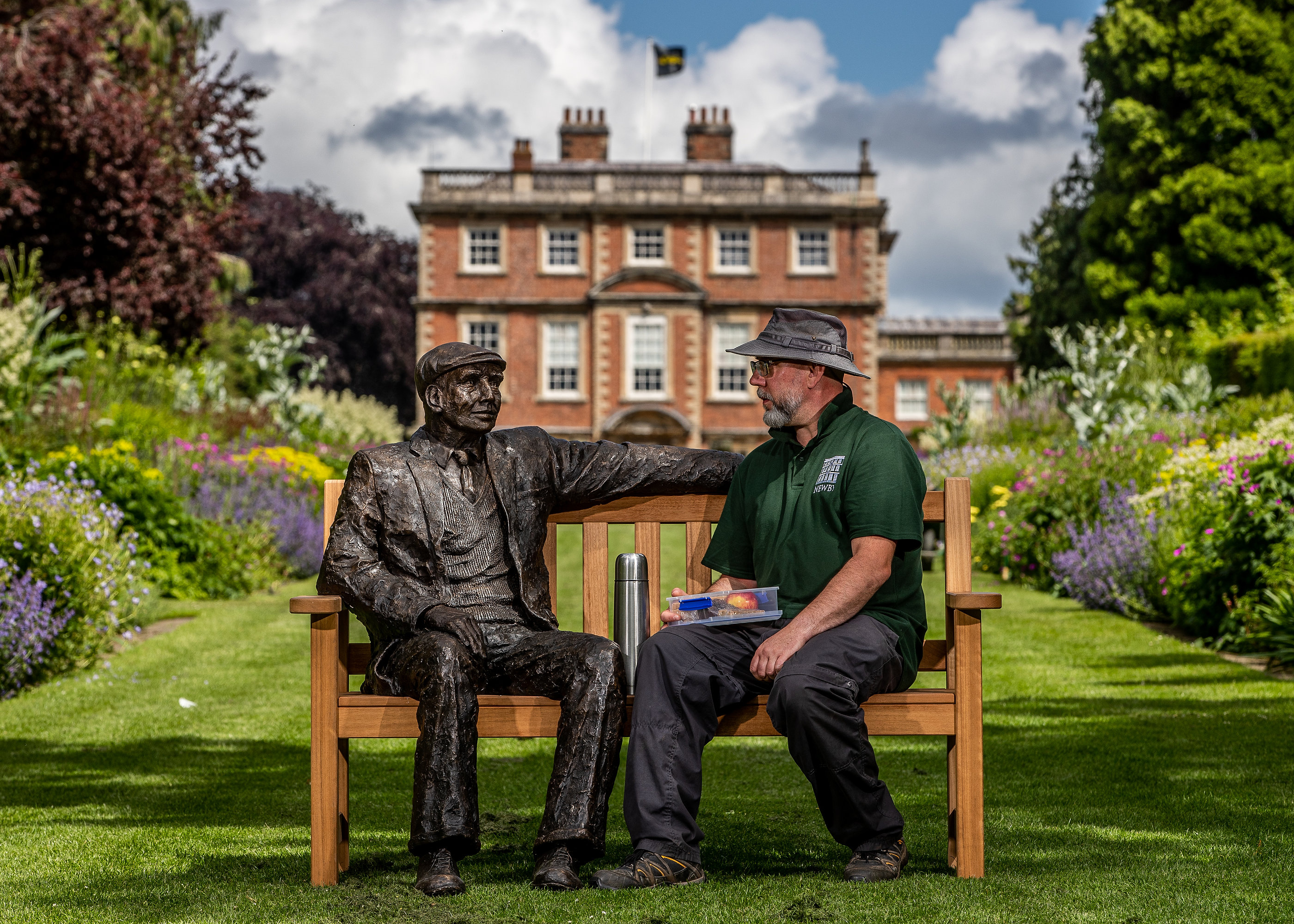 "Dave the Gardener takes a rest with ""Yorkshireman on a Bench"" by Jill Atley at Newby Hall"